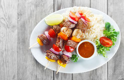 Gourmet Kebabs on Plate with Sauce and Rice Royalty Free Stock Image