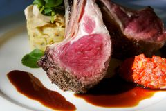 Gourmet lamb chops with garnishes Royalty Free Stock Photos