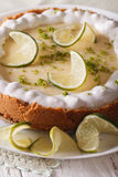 Gourmet lime tart with whipped cream and peel closeup. Vertical Stock Photography