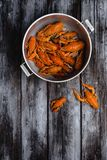 Gourmet lobsters in pan on rustic wooden table royalty free stock photos