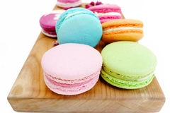 Gourmet macaron colorful cookies on wood desk. Isolated on white background Royalty Free Stock Image