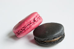 Gourmet Macaroons. Berry & liquorice flavoured gourmet macaroons against a white background Stock Images