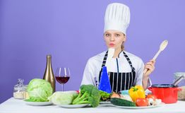 Gourmet main dish recipes. Cooking is her hobby. Cooking healthy food. Girl in hat and apron. Woman chef cooking healthy royalty free stock images