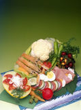 Gourmet meal. Table filled with gourmet menu on the green background royalty free stock image