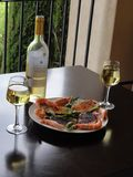 A gourmet meal, white wine, salmon, prawns royalty free stock photography