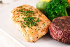 Gourmet meat  feast. Chicken breast and fillet mignon a nutritious combination Royalty Free Stock Photos