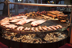 Gourmet meat pieces pork ribs, sausages, on a large grill . Stock Images