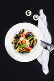 Gourmet mussels with fresh italian pasta, cherry tomato and herb Stock Image