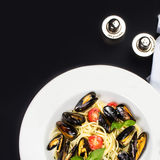Gourmet mussels with fresh italian pasta, cherry tomato and herb Royalty Free Stock Photo
