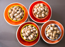 Gourmet nuts in spectacular multi-colored plates Royalty Free Stock Image