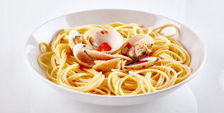 Gourmet Paella Pasta with Shells on White Plate Royalty Free Stock Image