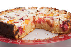 Gourmet Peach and Raspberry Cake. With a Piece Taken Out royalty free stock image