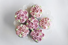 Gourmet pink decorated cupcakes on table Royalty Free Stock Photography