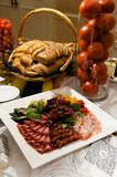 Gourmet plate of meats and olives Stock Photos