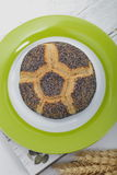 Gourmet poppy seed roll on a plate Stock Photo