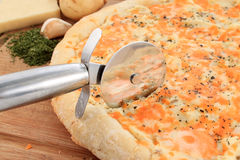Gourmet potato pizza and cutter Stock Photo