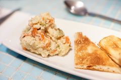 Mixed vegetable potato salad with pita bread as an appetizer royalty free stock photos