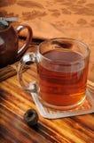 Gourmet Pu-erh tea. Pu-erh tea molded into an nest with a teapot Royalty Free Stock Photography