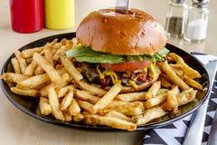 Gourmet Pub Hamburger and Fries Stock Images