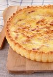 Gourmet quiche. On board and spoon Royalty Free Stock Image