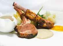 Gourmet rib beef steak ready to serve. On white plate. Close up and selective focus royalty free stock image