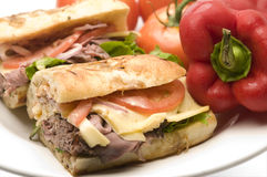 Gourmet roast beef sandwich. Havarti cheese lettuce tomato red onion remoulade dressing on rustic rosemary bread Stock Photos