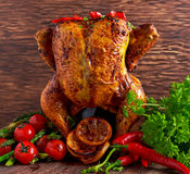 Gourmet Roast Whole organic chicken on cider Can With Asparagus, glazed Cherry Tomatoes, Herb and Spices, Served  Top of Royalty Free Stock Image