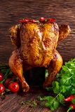 Gourmet Roast Whole organic chicken on cider Can With Asparagus, glazed Cherry Tomatoes, Herb and Spices, Served  Top of Stock Image