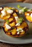 Gourmet Roasted Peaches with cheese and basil Royalty Free Stock Images