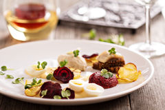 Gourmet salad with beet and herring Royalty Free Stock Images