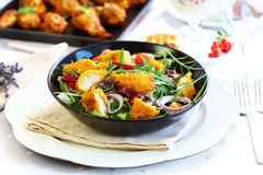 Gourmet salad with curry chicken stripes Stock Photos
