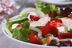 Gourmet salad of strawberries, cheese, vegetables, chicken. Gourmet salad of strawberries, feta cheese, vegetables and chicken breast macro horizontal Stock Photo