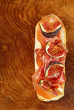 Gourmet sandwich with smoked ham (Parma) and figs Stock Photo