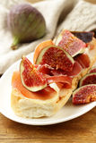 Gourmet sandwich with smoked ham (Parma) and figs Stock Photography