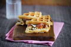 Gourmet sandwich of waffles, prosciutto, cheese and mushrooms Royalty Free Stock Photos