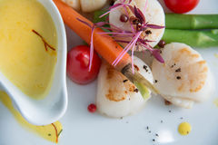 Gourmet seared scallops with garnishes. Royalty Free Stock Images