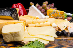 Gourmet selection of cheeses on a cheeseboard Stock Images