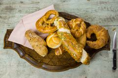 Gourmet selection of fresh bread rolls and pretzel stock image