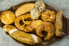 Gourmet selection of fresh bread rolls and pretzel stock images