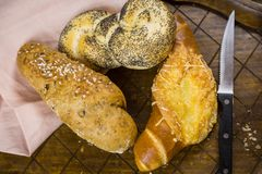 Gourmet selection of fresh bread rolls and pretzel stock photography
