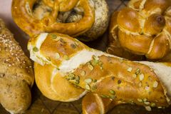 Gourmet selection of fresh bread rolls and pretzel royalty free stock image