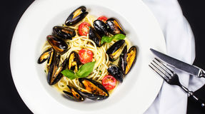 Gourmet Shellfish with fresh italian pasta, cherry tomato and he Royalty Free Stock Image