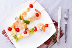 Gourmet Shrimp Skewers or Kebabs on White Plate Royalty Free Stock Photos
