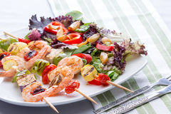 Gourmet shrimp skewers with salad greens Stock Photo