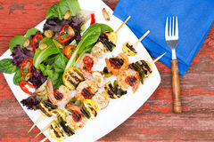 Gourmet shrimp skewers with salad greens Stock Photography