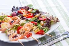 Gourmet Shrimp Skewers With Salad Greens Stock Photo