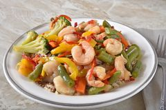 Gourmet shrimp stir fry on quinoa and rice stock image