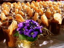 Gourmet shrimps with flowers. Gourmet shimp coctail shots  with bright blue flowers Royalty Free Stock Photography