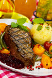 Gourmet Steak with Green Beans,Cherry Tomato,Cranb Royalty Free Stock Photography