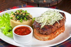 Gourmet steak meat. With potato, vegetables and sauce stock images
